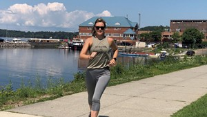 Katie Spotz finishing her run to the Burlington waterfront
