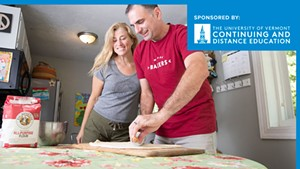 Rob Bousquet and his wife Brooke roll out some pizza dough