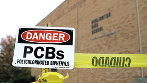 Signs warning about PCBs at Burlington High School