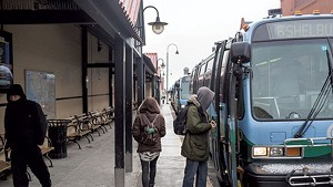 CCTA riders board buses on Cherry Street in Burlington.