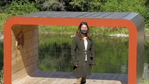 "Lisa Mitchell in front of ""Oona's Bridge"" by Silver Maple Construction"