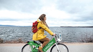 A cyclist on a Greenride bike in Burlington