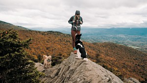 Maura Wieler with her two dogs atop Stowe Pinnacle
