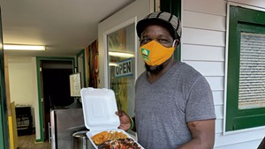 "Bilon ""Richie"" Bailey with takeout from Jamaican Supreme"