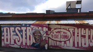 Anthill Collective's Bernie Sanders mural behind ArtsRiot