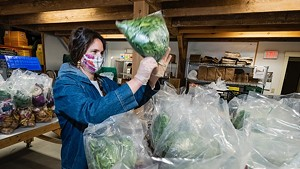 Andrea Solazzo packs produce for food shelf delivery