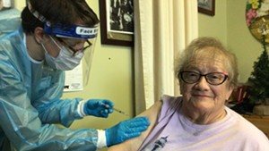 Helen Porter Rehabilitation and Nursing resident Elsie Johnson gets vaccinated on Monday.