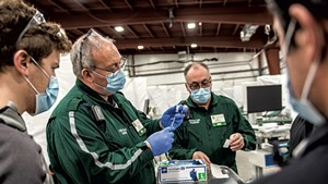 Preparing doses of the Pfizer COVID-19 vaccine at a University of Vermont Health Network vaccination clinic at the Champlain Valley Exposition