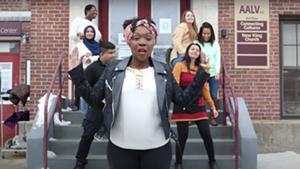 """KeruBo's Irene Kerubo Webster (center) with AALV staff in the """"Chanjo"""" video"""