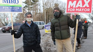 Candidates Miro Weinberger (left) and Max Tracy at a honk-and-wave Friday evening