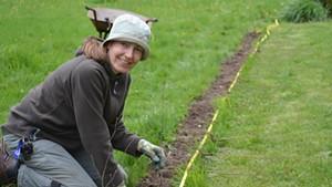 Silvia Jope planting a bare root hornbeam hedge