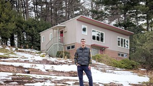Devin Colman in front of his favorite midcentury house in Burlington