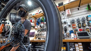 Shop manager Mar Kuhnel tuning a bike at Ranch Camp