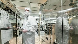 A GlobalFoundries employee working on the production floor in Essex Junction