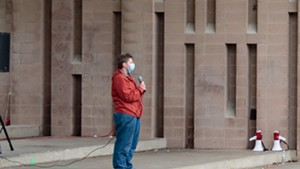 Lee Morrigan addresses a small crowd at Burlington's Battery Park during a demonstration for Ralph Jean-Marie last month