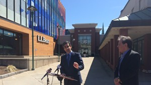Mayor Miro Weinberger, left, and Don Sinex discuss their agreement with reporters outside the Burlington Town Center Wednesday.
