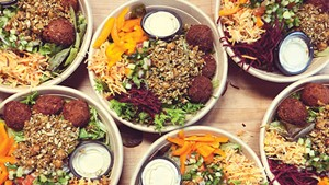 Honey Road falafel salads packed for takeout