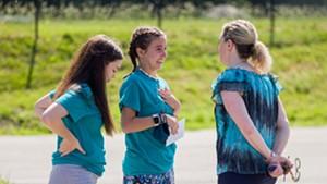 Maddie Goddard and Hannah Sheppard speak to Rice Principal Lisa Lorenz.