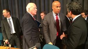 Sen. Cory Booker (D-N.J.) talks with Burlington Mayor Miro Weinberger as Sen. Patrick Leahy (D-Vt.) looks on.