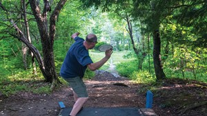 A disc golfer at Center Chains in Waterbury Center