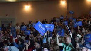 Vermont Democratic state convention delegates wave Bernie Sanders placards.