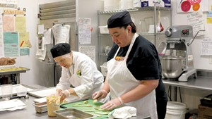 Chef-instructor Robin Burnett (left) and participant Stacey Clarke in the Vermont Works for Women Fresh Food Enterprise training program in 2015