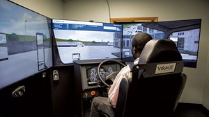 Rolph Belizaire, a student at Pro Driver Training, practicing on the Virage truck simulator