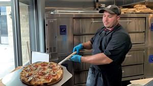 Pizza cook Samir Ramadanovic at Jr's Williston