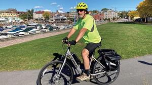 Ken Picard on a Local Motion e-bike on the Burlington Greenway