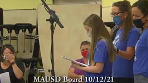 Teacher Victoria Thompson reading her statement to the school board