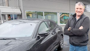 Rick Welcome with an all-electric Ford Mustang Mach-E at Lamoille Valley Ford in Hardwick