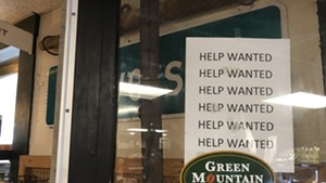 A sign at the Marshfield Village store