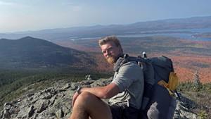 Brandon Weis atop a mountain in Maine