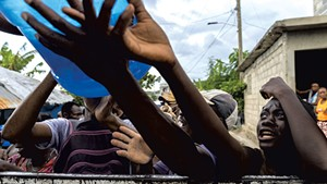 People waiting at the water distribution  in southwest Haiti