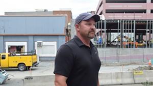 Heath McAllister defends his father, Sen. Norm McAllister, during an interview outside court.
