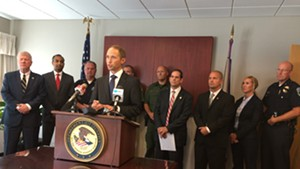 U.S. Attorney Eric Miller is joined by local and federal law enforcement officials during a press conference in Burlington.