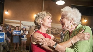 Democratic gubernatorial nominee Sue Minter embraces former governor Madeleine Kunin Tuesday night in Burlington.