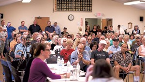Rutland residents hear about refugee resettlement plans last May at a meeting of the Board of Aldermen.