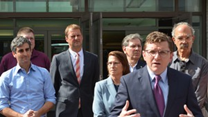From left: Burlington Mayor Weinberger, John St.Hilaire of Vermont Gas, Corix chief operating officer and vice president Eric van Roon, Dawn LeBaron of UVM Medical Center, Don Sinex, BED director Neale Lunderville and Jan Schultz announce plans to pursue district heating on Wednesday.