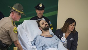 Steven Bourgoin is wheeled into his arraignment at the UVM Medical Center Friday morning.