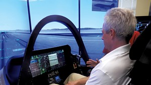 Adam L. Alpert in F-35 simulator