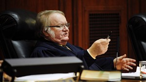 Justice John Dooley weighs in during Tuesday's hearing about appointing his replacement.
