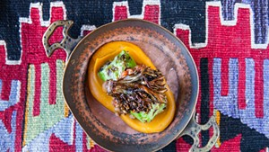 Lamb and cabbage sarma with sweet potato purée and crispy hen-of-the-woods mushrooms