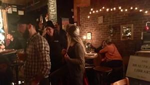 Attendees mingle at the Richard Brautigan Group Art Show at Radio Bean in Burlington.