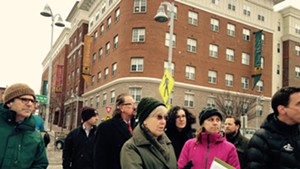 Marcy Harding, holding legal pad, leads a hotel site visit Monday.