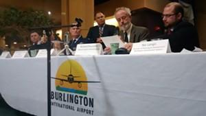 Richard Doucette presents at the Burlington airport.