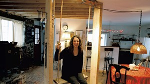 Stacy Hopkins in her jewelry studio, formerly a blacksmith shop
