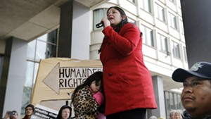 Lymarie Deida holds her daughter, Solmarie Carrillo, as she speaks about her husband, Alex Carrillo, at a rally outside a Boston court on Monday.