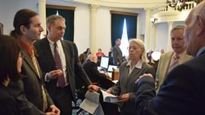Sen. Dick Sears (right to left) confers with Sens. Bobby Starr and Peg Flory, Senate Secretary John Bloomer, Lt. Gov. David Zuckerman and Sen. Becca Balint on the Senate floor Friday.