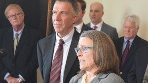 Gov. Phil Scott and his legal counsel, Jaye Pershing Johnson, at a press conference